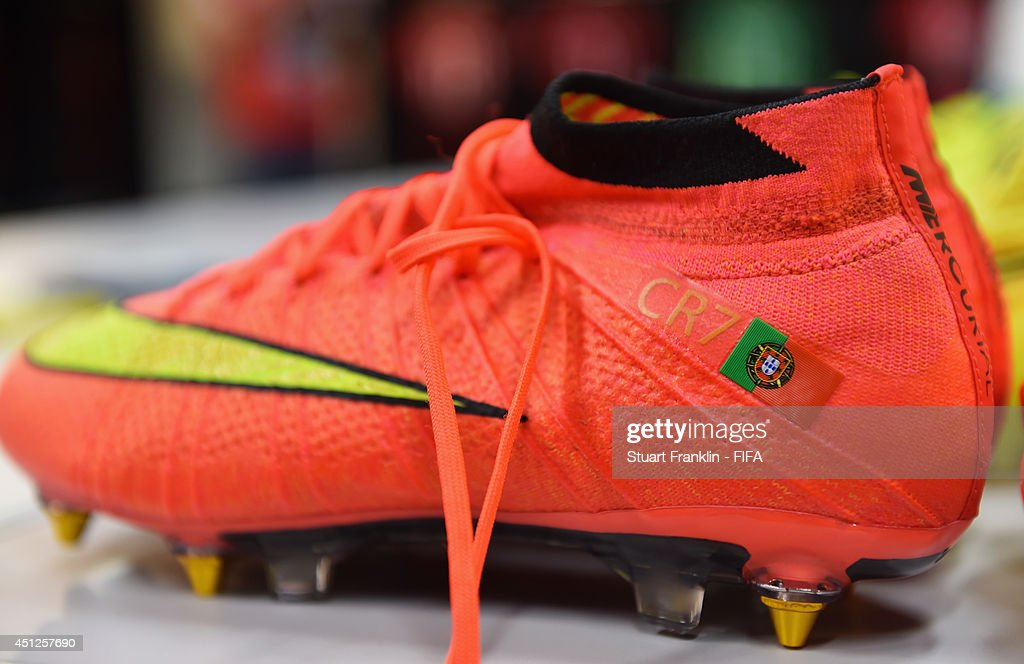 The football boots worn by Cristiano Ronaldo of Portugal are displayed in the dressing room prior to the 2014 FIFA World Cup Brazil Group G match between Portugal and Ghana at Estadio Nacional on June 26, 2014 in Brasilia, Brazil.