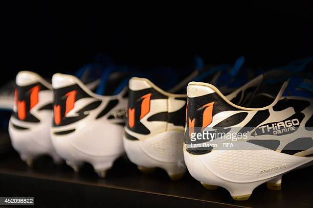 The football boots worn by Lionel Messi of Argentina are seen in the dressing room prior to the 2014 FIFA World Cup Brazil Final match between...