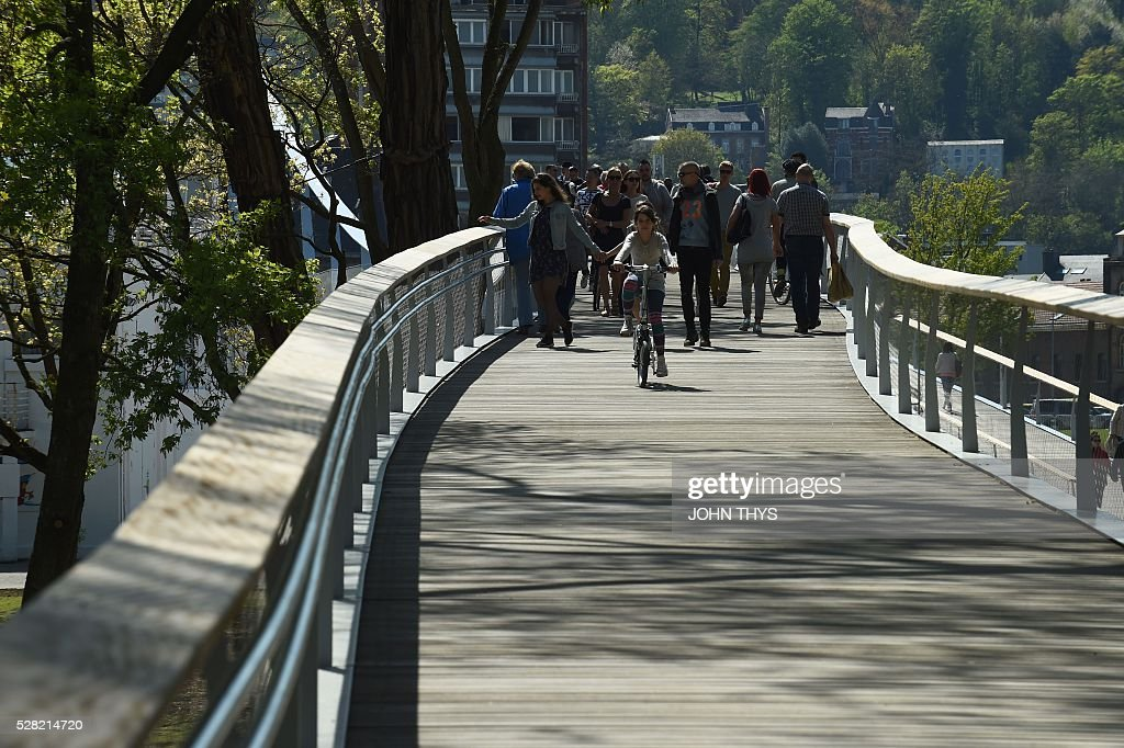 The footbridge La belle Liegeoise is pictured next to the La Boverie museum on May 4, 2016 in Liege. The new museum La Boverie was inaugurated today, with an exhibition organised in partnership with Le Louvre museum. / AFP / JOHN