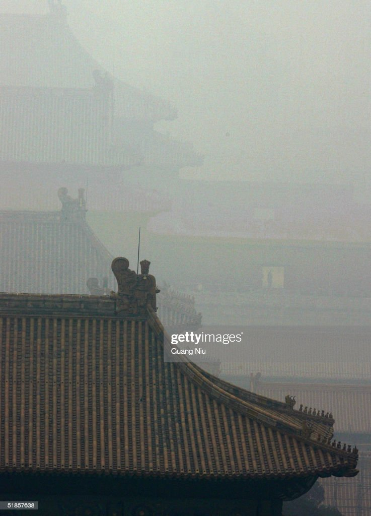 The Forbidden City is shrouded in heavy fog on December 14, 2004 in Beijing, China. The bad weather has made it harder for Beijing to achieve the target of 18 clear-sky days in December, laid out by the environmental protection campaign, which requires the capital to have clear sky for 62 percent of the year, equivalent to 227 days. Beijing has pledged to cleanse the skies before the 2008 Olympic Games.