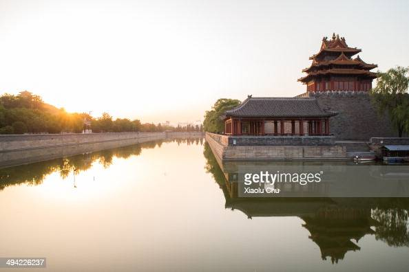 The Forbidden City watchtower is seen at sunrise on May 29 2014 in Beiking China The temperature reached 38 degress Celsius making it May 29th the...