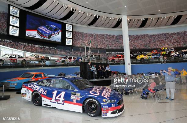 The Ford Fusion for StewartHaas Racing car driven by Clint Bowyer is unveiled during the Darlington Throwback Paint Scheme Unveil at NASCAR Hall of...