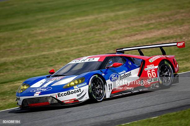The Ford GT of Joey Hand Dirk Muller and Sebastien Bourdais drives on the track during the ROAR Before the 24 test session at Daytona International...