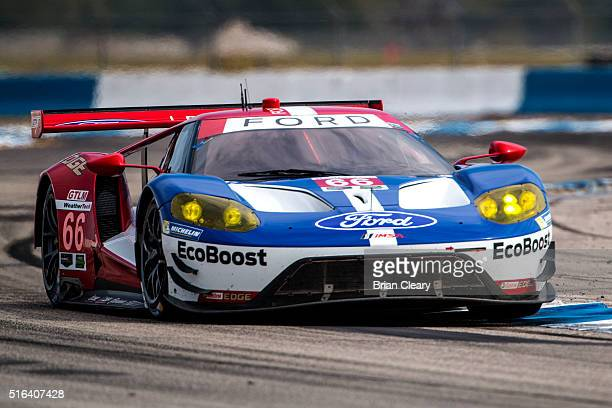 The Ford GT of Joey Hand Dirk Muller and Sebastien Bourdais races through a turn during practice for the 12 Hours of Sebring IMSA WeatherTech Series...