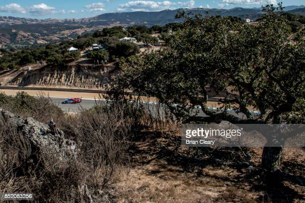The Ford GT of Ryan Briscoe of Australia and Richard Westbrook of Great Britain races through the California countryside during practice for the IMSA...