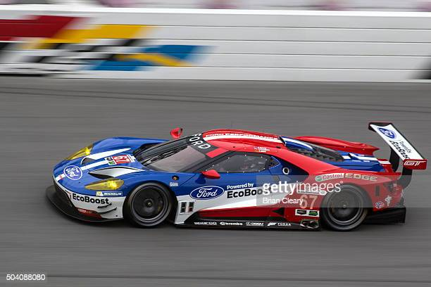 The Ford GT of Ryan Brisoe Richard Westbrook and Stefan Mucke drives on the track during the ROAR Before the 24 test session at Daytona International...
