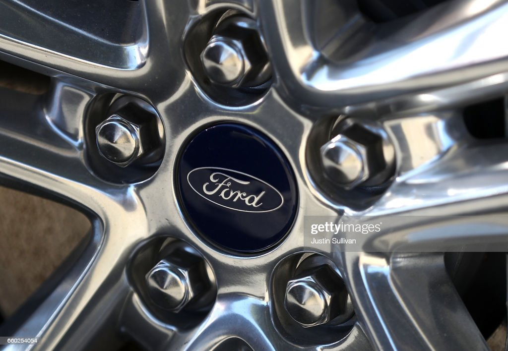 The Ford logo is displayed on the wheel of a new Ford car on the sales & Ford Recalls Almost Half Million Vehicles To Fix Engine Fire ... markmcfarlin.com
