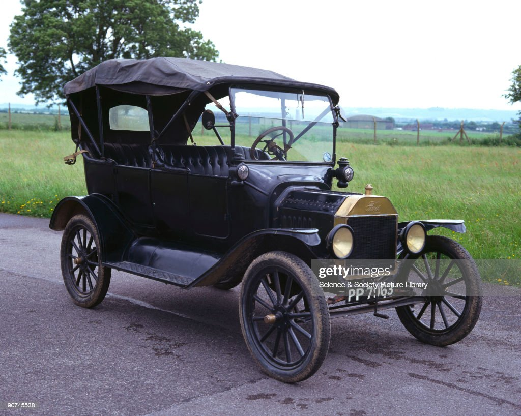 The Ford Model T was introduced by Henry Ford (1863-1947) in 1908 & Ford Model T four-seat tourer motor car 1916. Pictures | Getty Images markmcfarlin.com