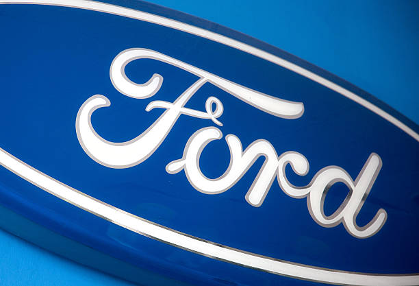 The Ford Motor Co Logo Adorns Wall Of Harpreet Dealership In New