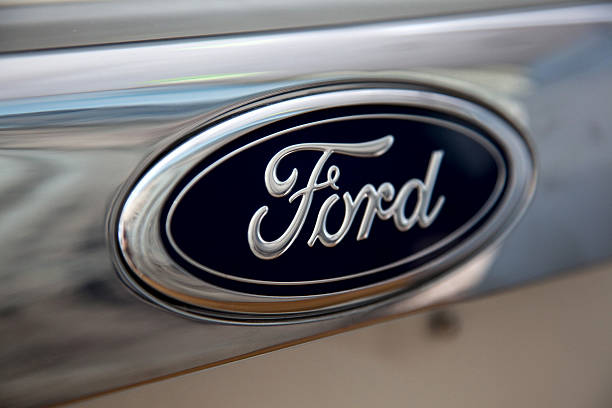 The Ford Motor Co Logo Is Displayed On A Vehicle At Harpreet Dealership