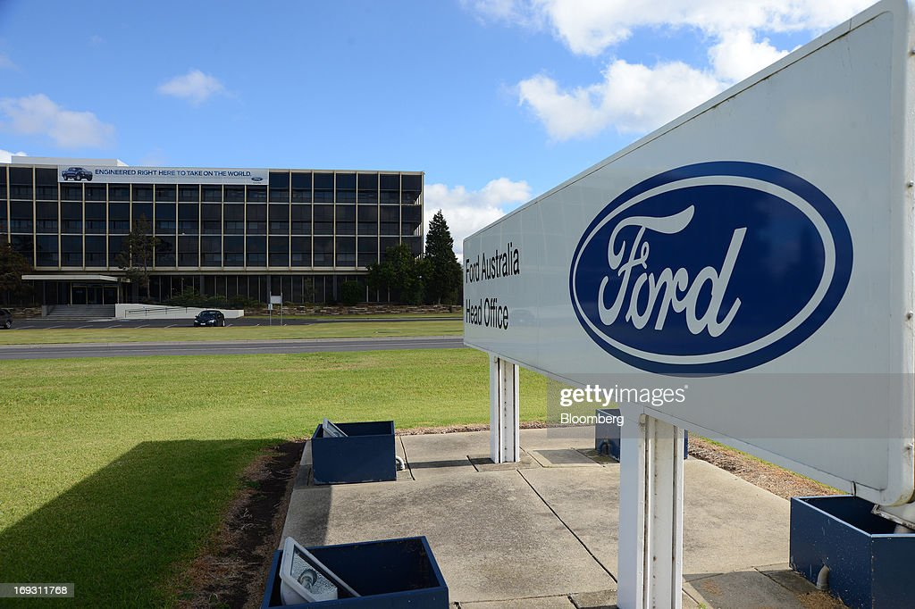 The Ford Motor Co. logo is displayed on signage outside the company's Australia head office in Melbourne, Australia, on Thursday, May 23, 2013. Ford will stop making cars in Australia, nine decades after founder Henry Ford first began building Model Ts in the country, as a surge in the currency undermines the local industry's ability to compete with imports. Photographer: Carla Gottgens/Bloomberg via Getty Images