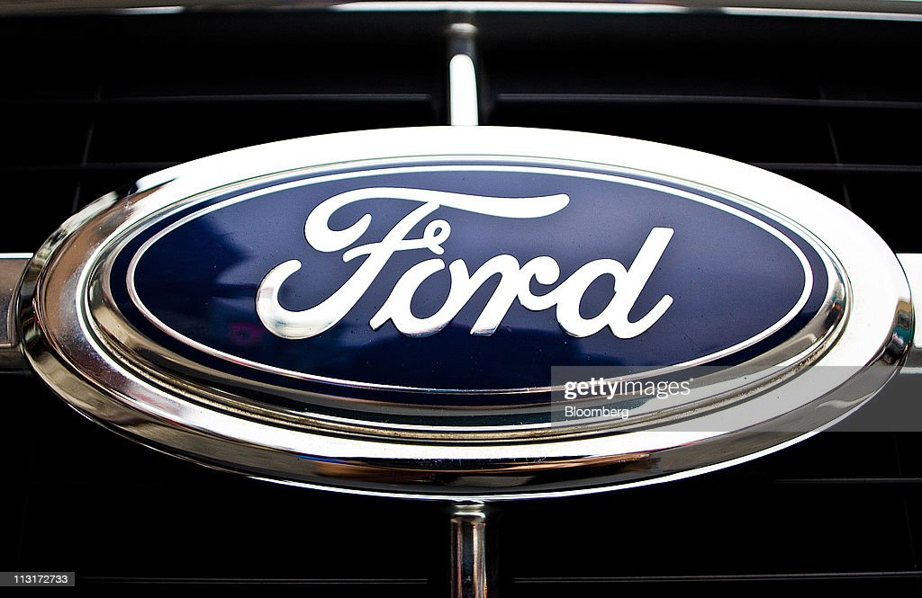 the ford motor co logo is displayed on the grill of a ford escape. Cars Review. Best American Auto & Cars Review