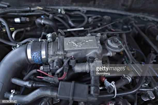 The Ford Motor Co Mustang logo is displayed on a V8 engine at the Autoverwertung Zimmermann GmbH scrapyard in Reichenburg Switzerland on Monday Aug...