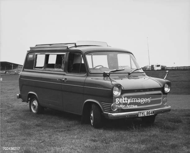 The Ford Motor Company Ltd Wayfarer camper based on the Ford Transit Custom 90 Van with rigid panel elevating roof canopy and produced by CI...