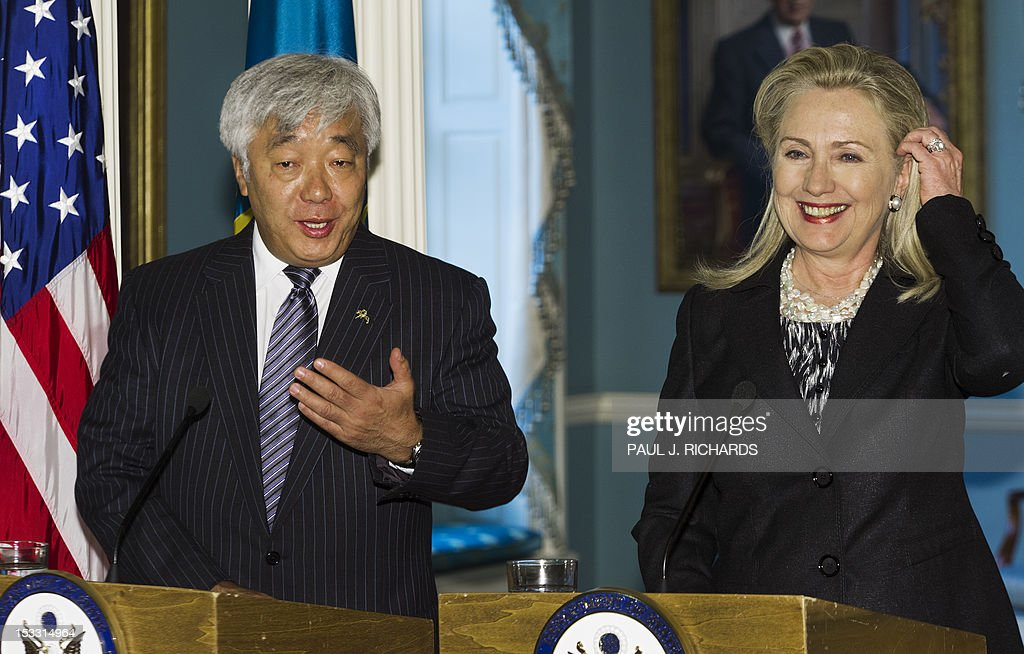 The Foreign Minister of Kazakhstan Yerlan Idrisov(L) and US Secretary of State Hillary Clinton deliver remarks to the media after their private bilateral meeting October 3, 2012, at the US Department of State in Washington, DC. AFP Photo/Paul J. Richards
