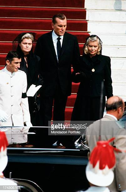 The former car driver John Young Stewart also known as Jackie Stewart goes down the stairs of the Cathedral of Monaco after the funeral celebrations...