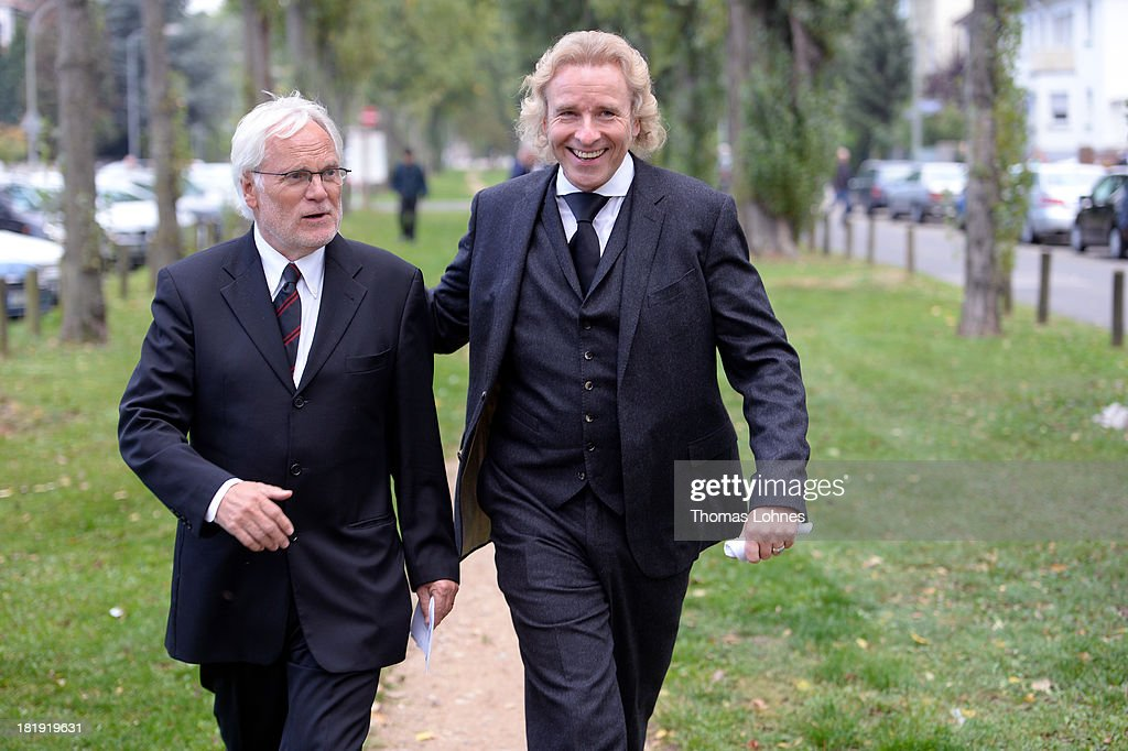 The former chairman of the television company ZDF, Markus Schaechter (L), and entertainer <a gi-track='captionPersonalityLinkClicked' href=/galleries/search?phrase=Thomas+Gottschalk&family=editorial&specificpeople=206369 ng-click='$event.stopPropagation()'>Thomas Gottschalk</a> walk after the funeral service for the literary critic Marcel Reich-Ranicki (1920 - 2013) on September 26, 2013 in Frankfurt am Main, Germany.