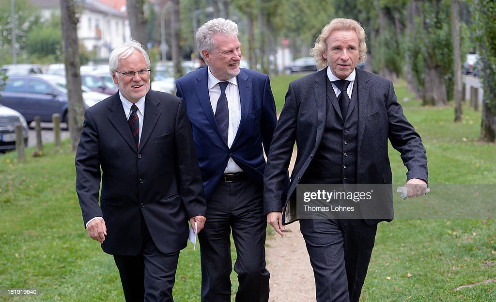 The former chairman of the television company ZDF, Markus Schaechter (L-R), the former chairman of a television company SWR, Peter Voss, and entertainer <a gi-track='captionPersonalityLinkClicked' href=/galleries/search?phrase=Thomas+Gottschalk&family=editorial&specificpeople=206369 ng-click='$event.stopPropagation()'>Thomas Gottschalk</a> walk after the funeral service for the literary critic Marcel Reich-Ranicki (1920 - 2013) on September 26, 2013 in Frankfurt am Main, Germany.