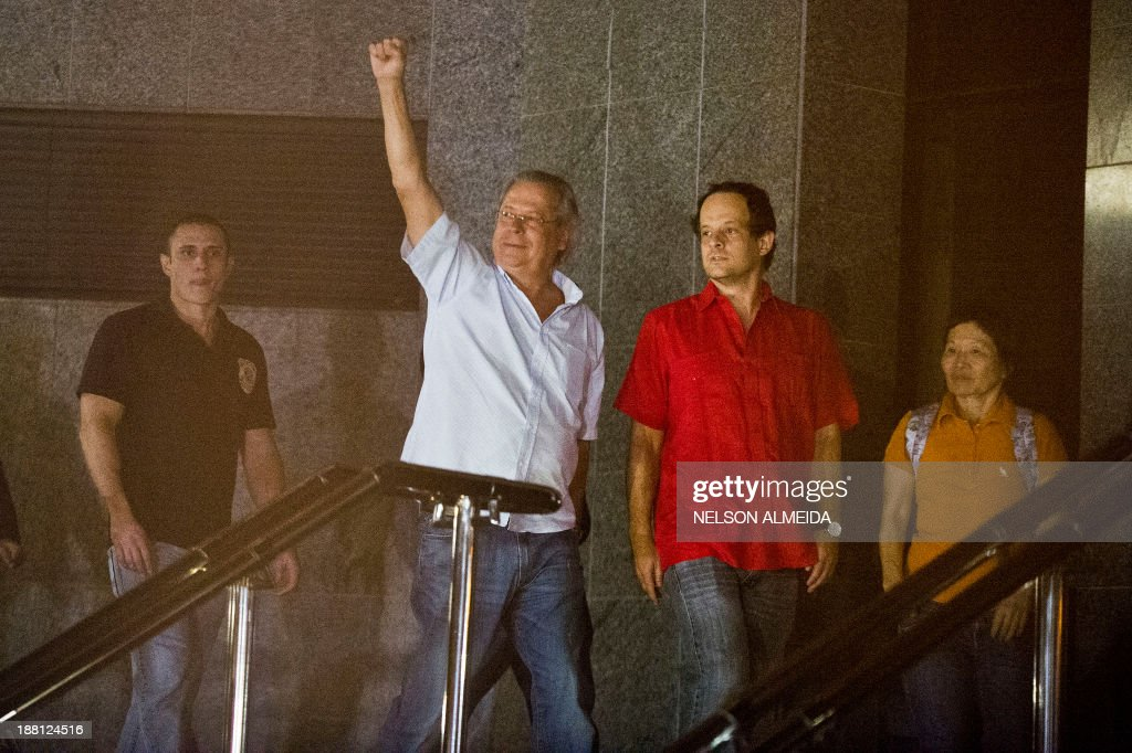 The former Chief of Staff of Brazilian President Luiz Inacio Lula da Silva, Jose Dirceu (C), one of the accused in the Mensalao scandal, arrives at the Federal Police headquarters in Sao Paulo, Brazil on November 15, 2013.