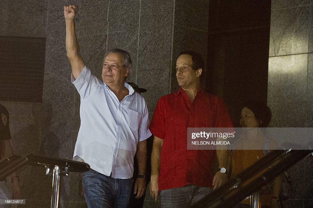 The former Chief of Staff of Brazilian President Luiz Inacio Lula da Silva, Jose Dirceu (L), one of the accused in the Mensalao scandal, arrives at the Federal Police headquarters in Sao Paulo, Brazil on November 15, 2013.