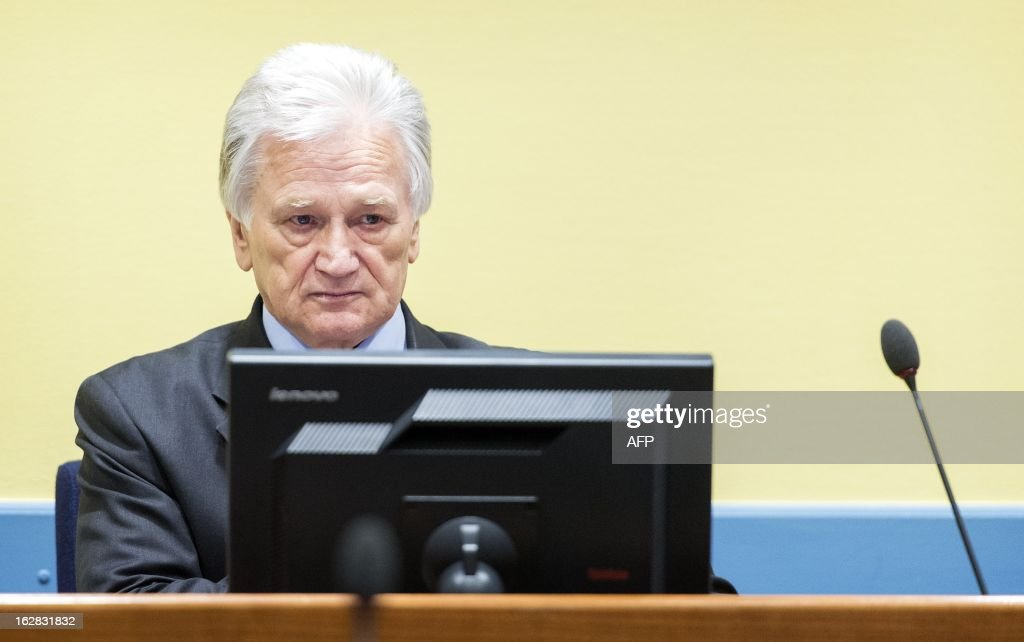The former chief-of-staff of the Yugoslav Army, Momcilo Perisic, sits on February 28, 2013 during his appeal judgement in a courtroom of the Yugoslav War Crimes Tribunal (ICTY) in The Hague. The UN war crimes court sentenced Perisic to 27 years in jail on Sepember 6, 2011 for helping the Bosnian Serb army murder and persecute Bosnian Muslims, including at Srebrenica in 1995. AFP PHOTO / POOL / KOEN VAN WEEL