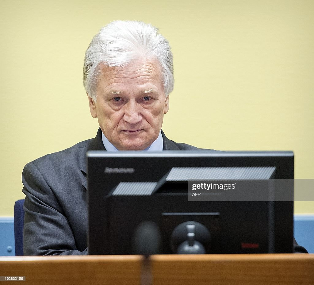 The former chief-of-staff of the Yugoslav Army, Momcilo Perisic (R), sits on February 28, 2013 during his appeal judgement in a courtroom of the Yugoslav War Crimes Tribunal (ICTY) in The Hague. The UN war crimes court sentenced Perisic to 27 years in jail on Sepember 6, 2011 for helping the Bosnian Serb army murder and persecute Bosnian Muslims, including at Srebrenica in 1995.