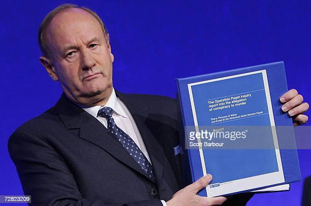 The former Commissioner of London's Metropolitan Police Lord Stevens holds a copy of the Operation Paget inquiry report after an official British...