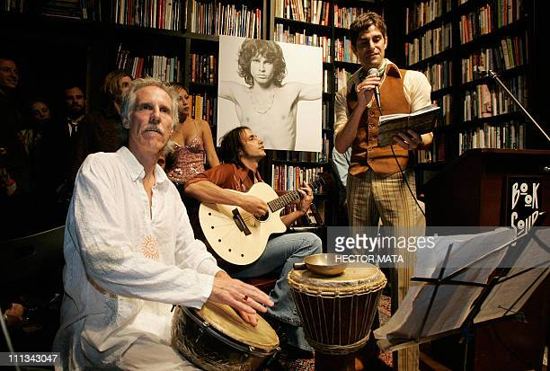 The former drummer of The Doors John Densmore performs as the former lead singer of 'Jane's Addiction' Perry Farrell reads poetry in Hollywood 08...