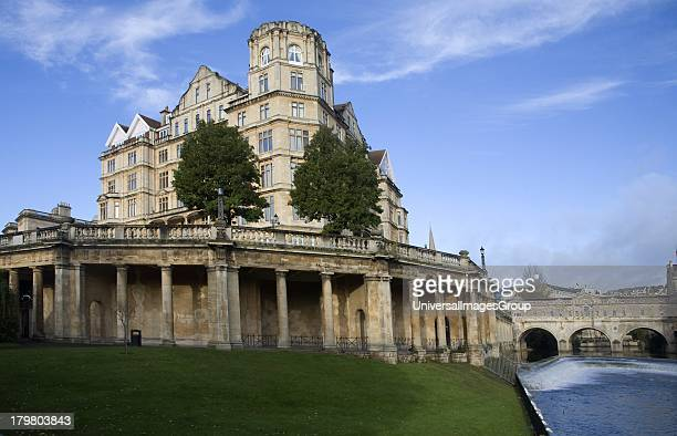 The former Empire Hotel River Avon and Pulteney Bridge from Parade Gardens Bath Somerset England