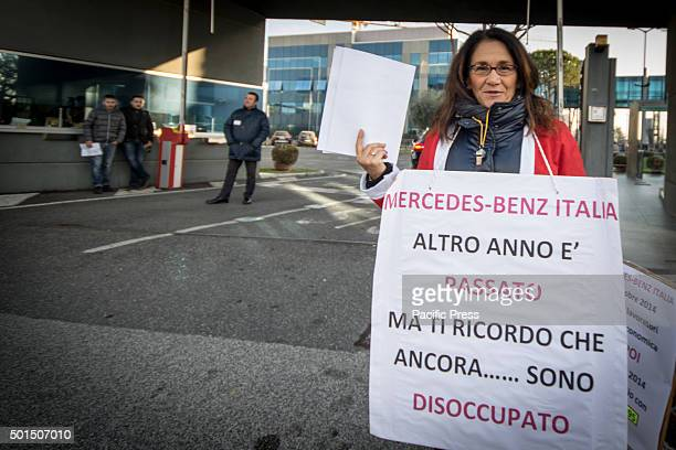 The former employee of Mercedes Benz brings placard during a protest outside the Mercedes Benz factory in Rome to demand full reinstatement The...