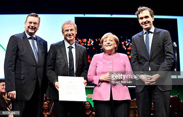 The former head coach of the German National and current head coach of the US Soccer National Team Juergen Klinsmann DFB president Reinhard Grindel...