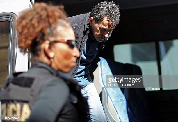 The former head of cabinet of Brazilian former Finance Minister Antonio Palocci Juscelino Antonio Dourado is pictured upon arriving under police...