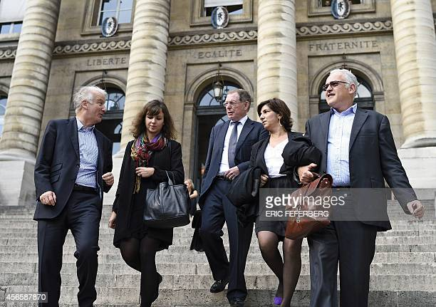 The former joint chairman of Airbus parent company EADS Noel Forgeard leaves with his lawyers Olivier Gutkes the palace of justice in Paris on...