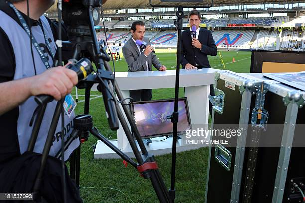 The former Ludovic Giuly and the 'BEIN' sport channel Cristophe Josse are waiting for the start of the French L1 football match Lyon vs Nantes on...