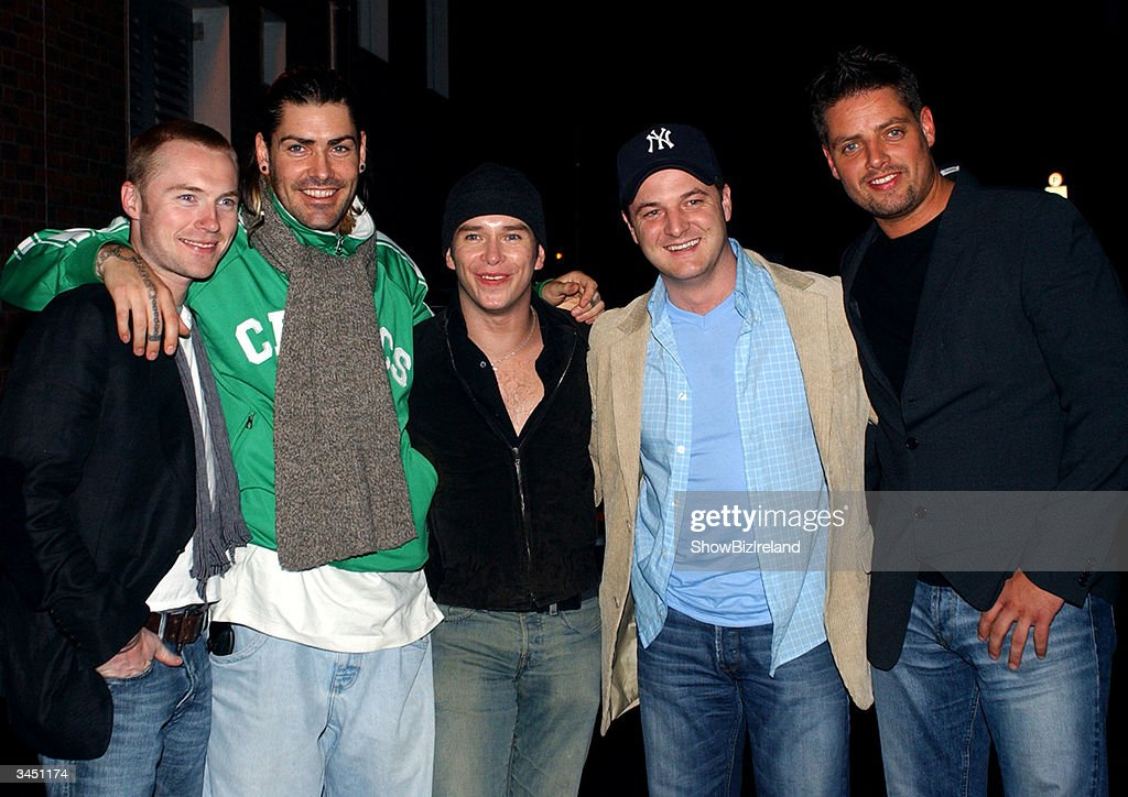 The former members of Boyzone (L-R) Ronan Keating, Shane Lynch, Stephen Gately, Mikey Graham and Keith Duffy stand outside Diep Shaker Restaurant April 20, 2004 in Dublin, Ireland.