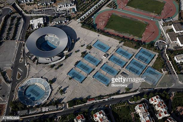 The former Olympic tennis stadium and tennis courts sit on the abandoned 2004 Olympic site in the Hellenikon district of Athens Greece on Thursday...