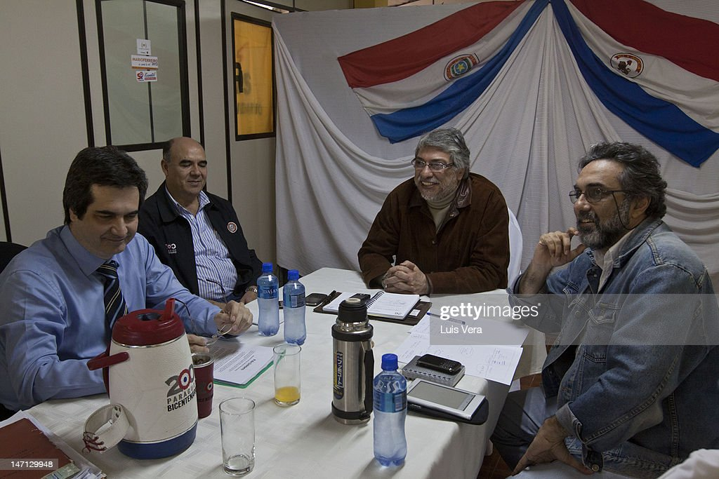 The former President of Paraguay <a gi-track='captionPersonalityLinkClicked' href=/galleries/search?phrase=Fernando+Lugo&family=editorial&specificpeople=587909 ng-click='$event.stopPropagation()'>Fernando Lugo</a> attends a meeting of the Pais Solidario Party with the Interior Minister, Carlos Filizzola (L), Miguel Rojas (L) and Gustavo Codas (R) on June 25, 2012 in Asuncion, Paraguay.