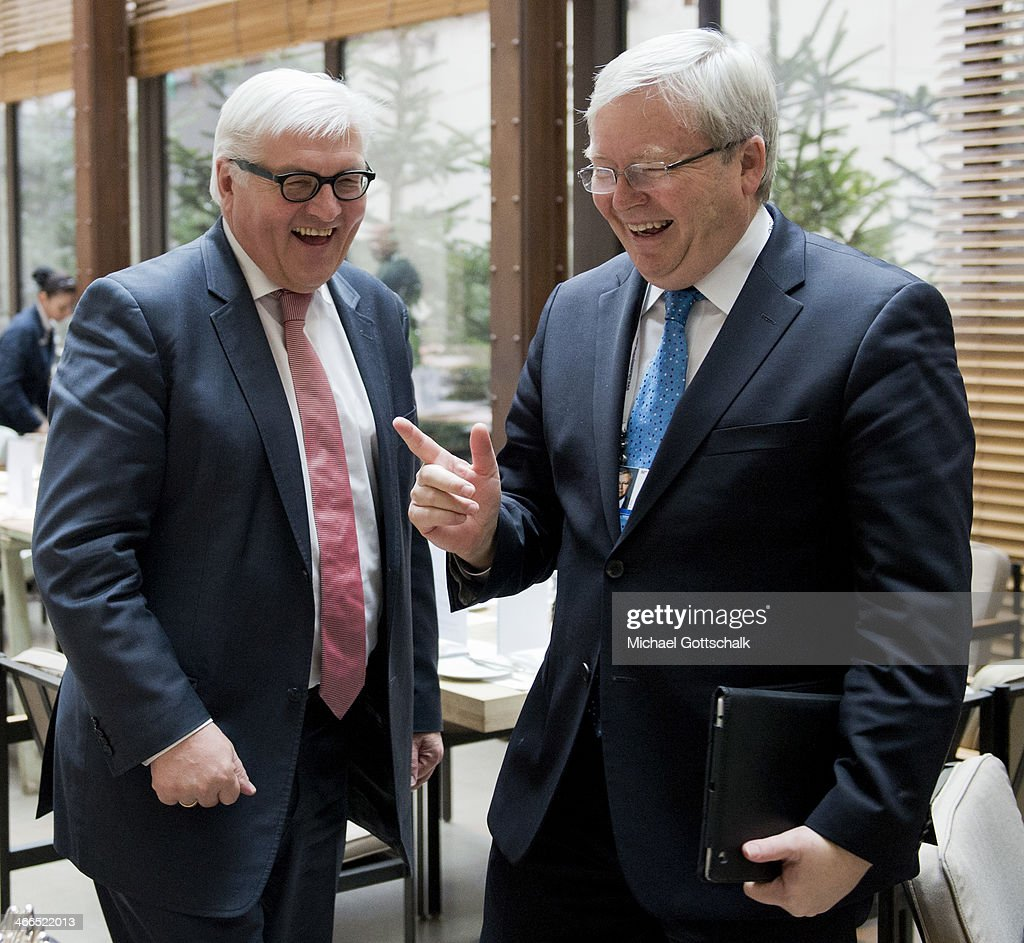 The former Prime Minister of Australia Kevin Rudd speaks with German Foreign Minister FrankWalter Steinmeier at the 50th Munich Security Conference...