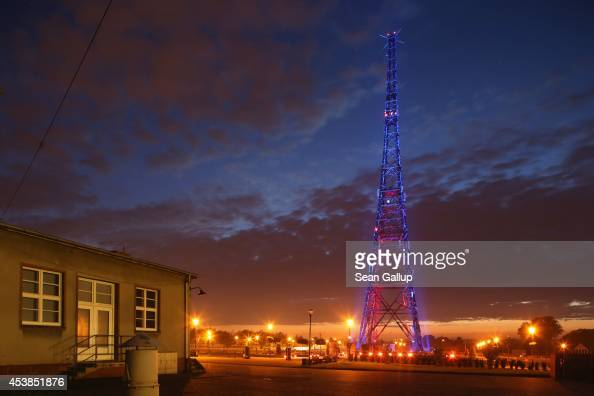 The former radio station tower that became famous through the 'Gleiwitz Incident' stands illuminated on August 19 2014 in Gliwice Poland On August 31...