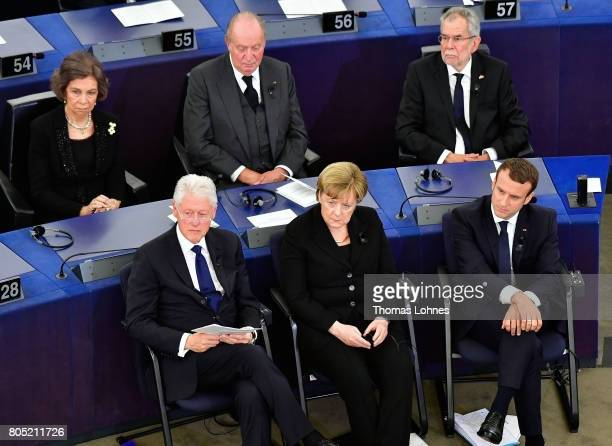 The former US President Bill Clinton German chancellor Angela Merkel French President Emmanuel Macron and King Juan Carlos of Spain and Queen Sofia...
