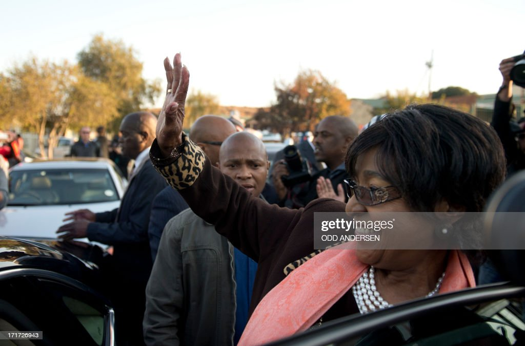 The former wife of Nelson Mandela, Winnie Mandela Madikizela, waves to well wishers after addressing media outside their first family home in Soweto on June 28, 2013. Winnie Mandela said 'there is great improvement in his health' Mandela is receiving treatment at the Mediclinic heart hospital in Pretoria. Mandela's close family gathered yesterday at his rural homestead to discuss the failing health of the South African anti-apartheid icon who was fighting for his life in hospital. Messages of support poured in from around the world for the Nobel Peace Prize winner, who spent 27 years behind bars for his struggle under white minority rule and went on to become South Africa's first black president. AFP PHOTO / ODD ANDERSEN