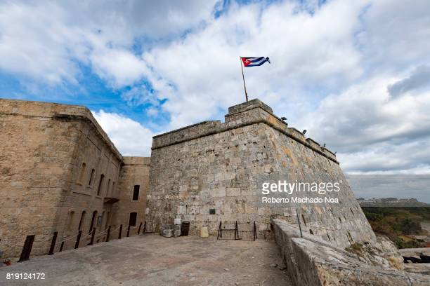 The fortress of 'El Morro' A Cuban National Flag flies above the fortress on a cloudy day