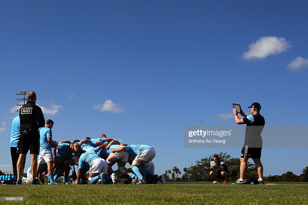 The forwards practise their scrum during a New Zealand All Blacks training session at Waitakere Stadium on October 26, 2013 in Auckland, New Zealand.