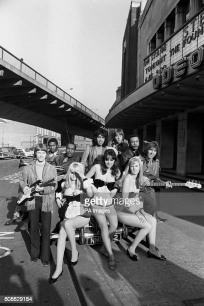 The Foundations and the pinup girls from the Penthouse Club unite for the group's opening night at the Odeon Hammersmith Left to right the girls...