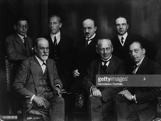 The founder of psychoanalysis Sigmund Freud sitting among some of his pupils Vienna 1922