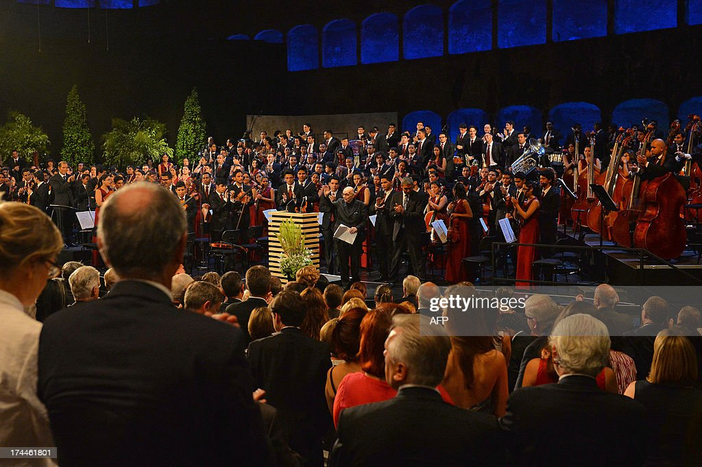 The founder of 'The System' (El Sistema) music project, Venezuelan Jose Antonio Abreu leaves the stage after delivering the keynote speech at the opening of the Salzburg festival in Salzburg on July 26, 2013The festival runs from Jul 19 to September 1, 2013 .