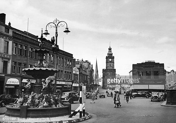 The fountain and Mid Steeple on the High Street in Dumfries 27th July 1946 Original Publication Picture Post 4154 In Praise Of Robert Burns pub 1946