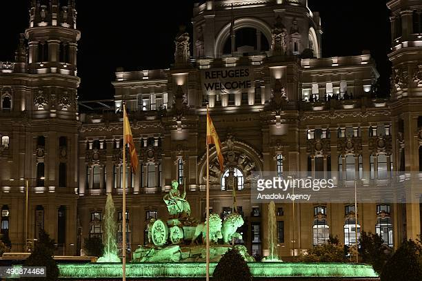 The fountain of Cybele illumitaned in green for the Arthritis awareness is seen in Marid Spain on October 01 2015 More than 300000 people with...