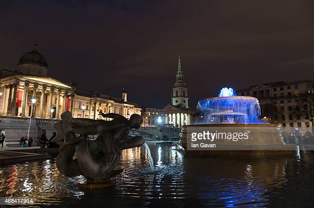 The fountains at Trafalgar Square are illuminated in blue to mark the World Autism Awareness Day on April 2 2015 in London England