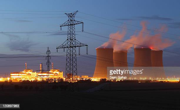 The four cooling towers and two reactor blocks of the Temelin nuclear power plant stand illuminated on August 11 2011 near Temelin Czech Republic CEZ...